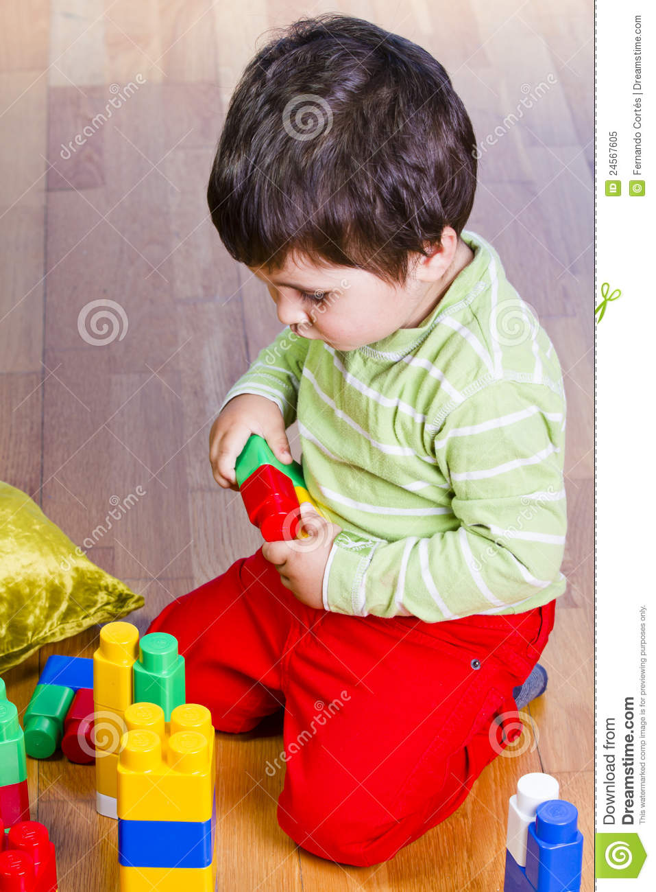 Building Toys For Little Boys : A happy little boy is building colorful toy stock image