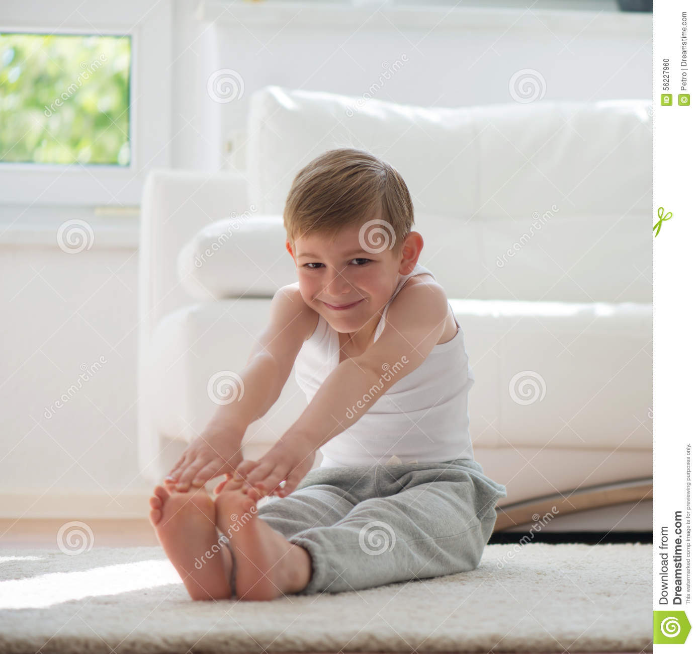 Happy Little Boy Exercising At Home Stock Photo