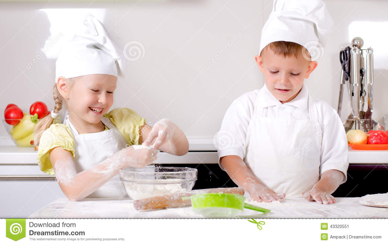 Happy Little Boy And Girl Cooking In The Kitchen Stock Image - Image ...