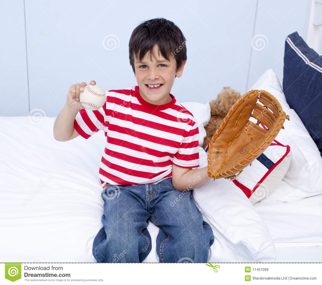 Happy Little Boy Playing Baseball In Bed Royalty Free ... Little Boy Playing Baseball