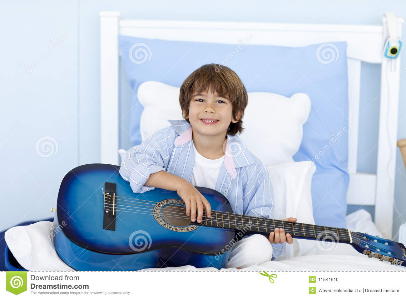 Happy Little Boy Playing Guitar In Bed Stock Photo Image