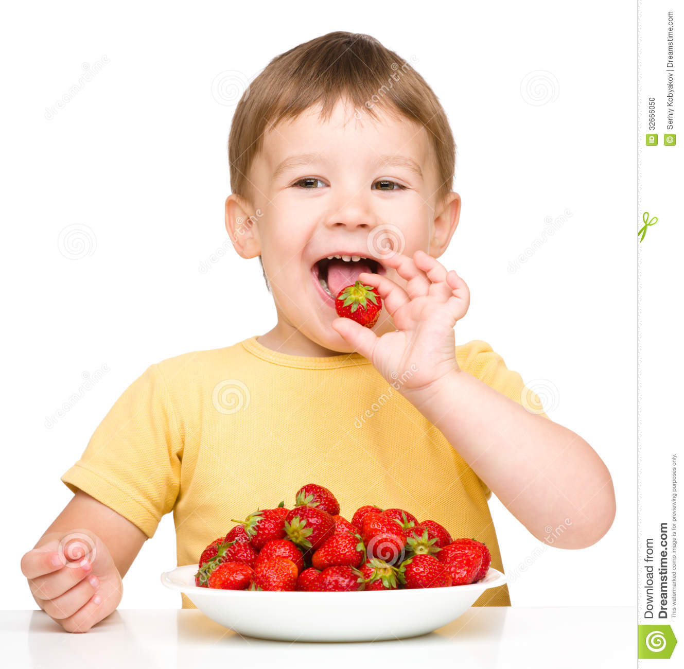 Happy Little Boy With Strawberries Stock Photo - Image: 32666050