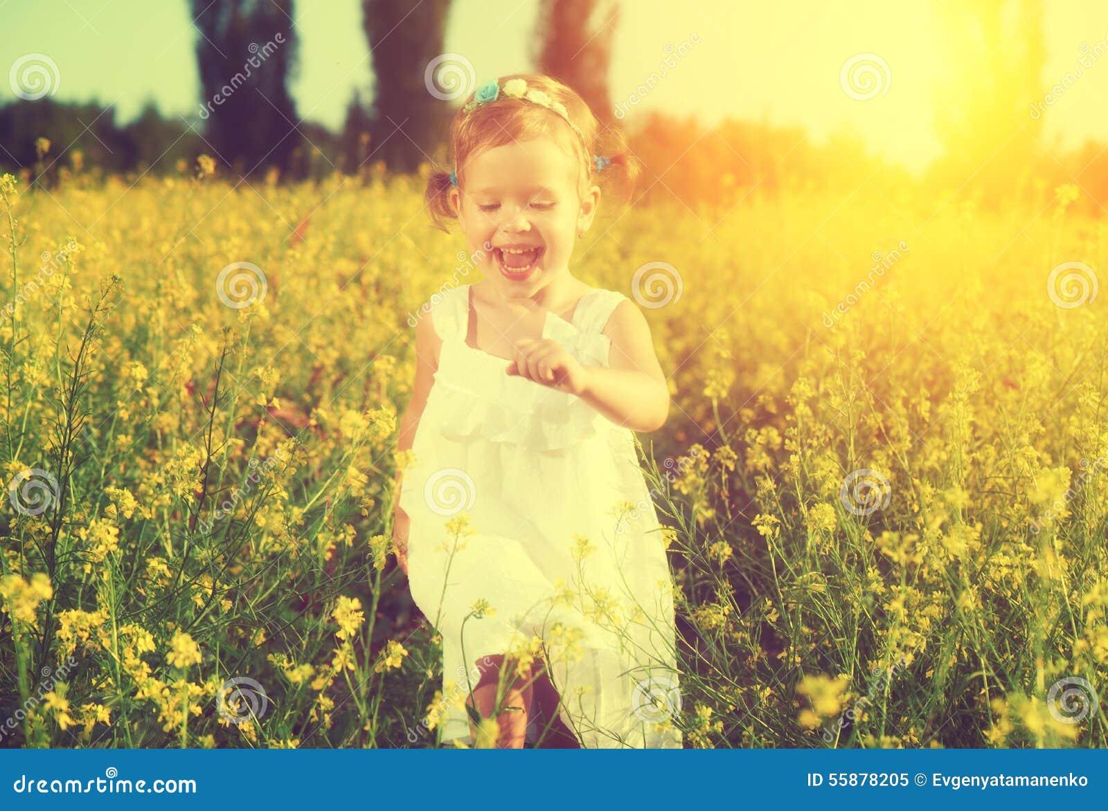 Children Nature Sunlight Blonde Depth Of Field White Dress: Happy Little Child Girl Running On Field With Yellow