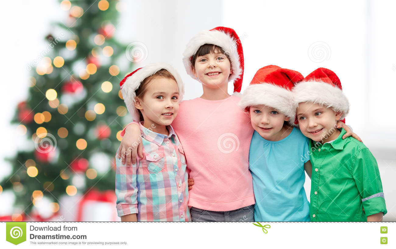 39d1f4ee3a8d4 Happy Little Children In Christmas Santa Hats Stock Image - Image of ...