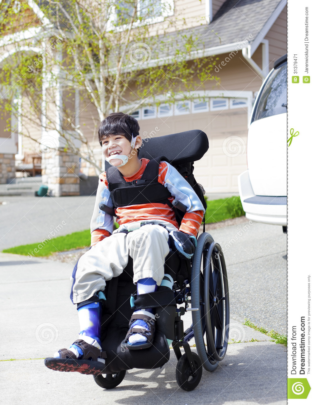 happy little disabled boy in wheelchair stock image image of cute