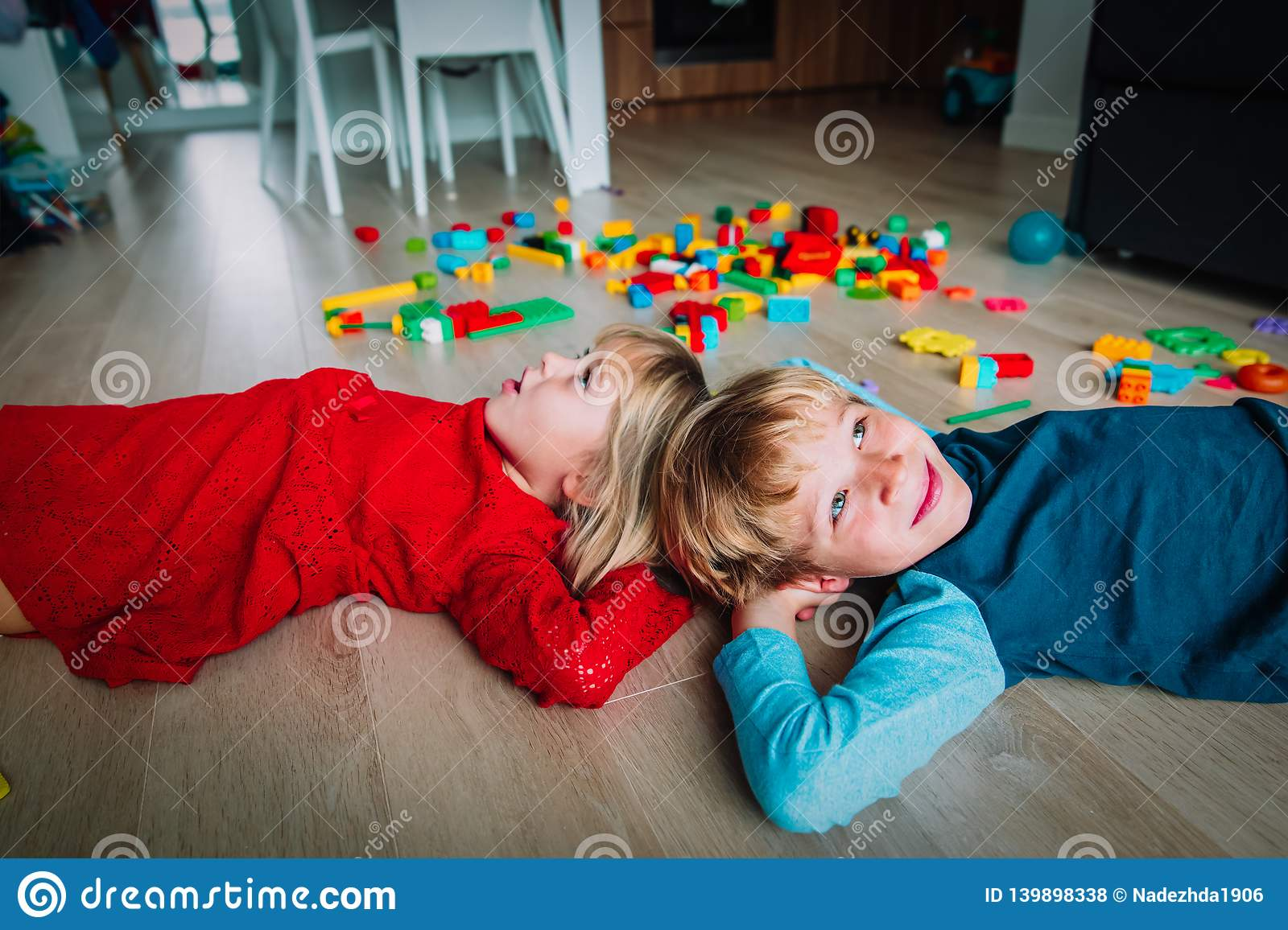 Happy little girl and boy enjoy play home