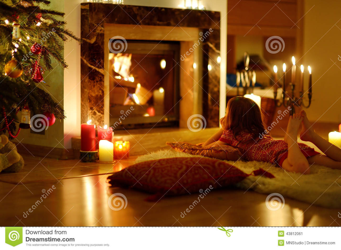 Happy Little Girl By A Fireplace On Christmas Stock Photo Image