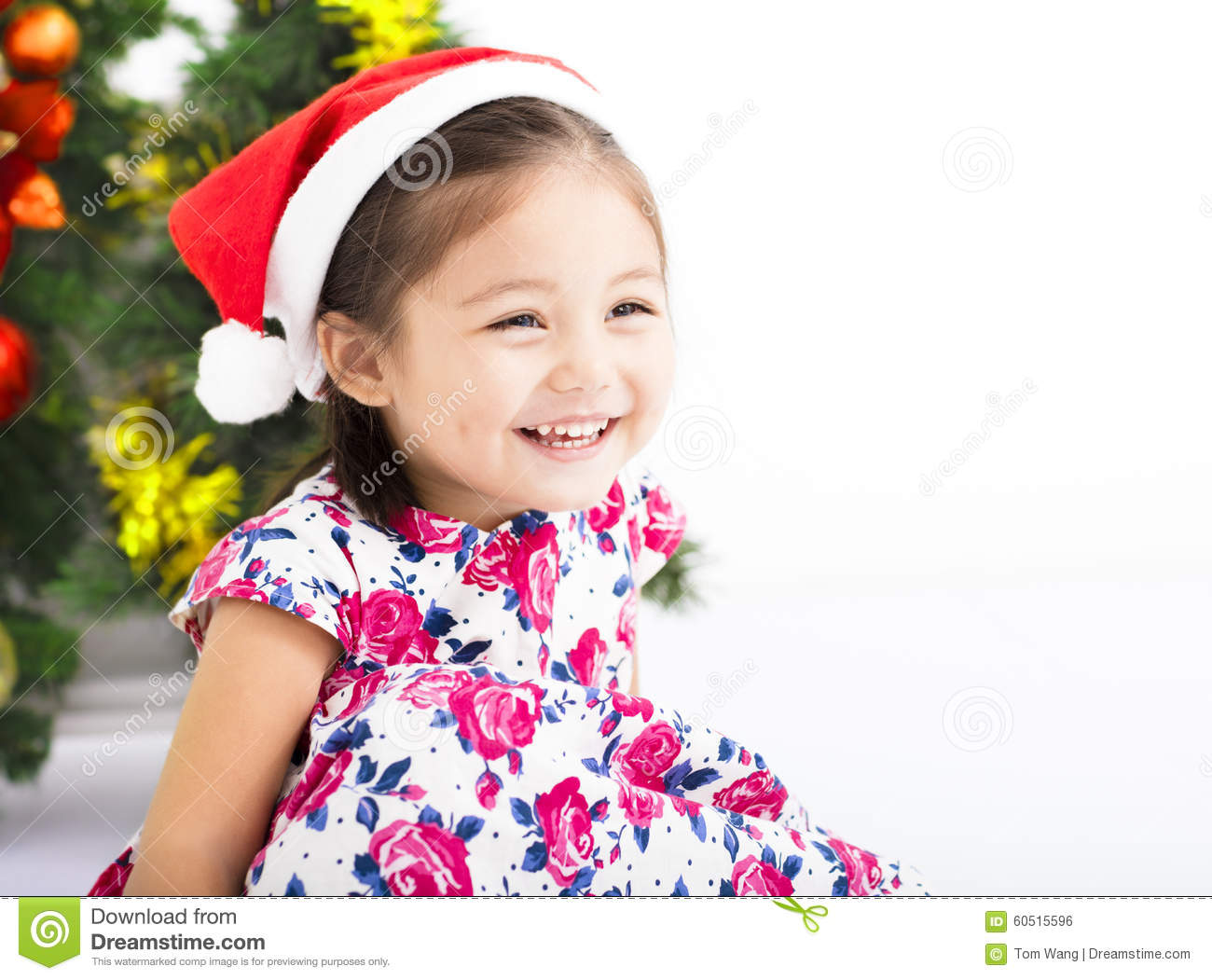 Portrait Of Little Girl In Front Of Christmas Tree Royalty