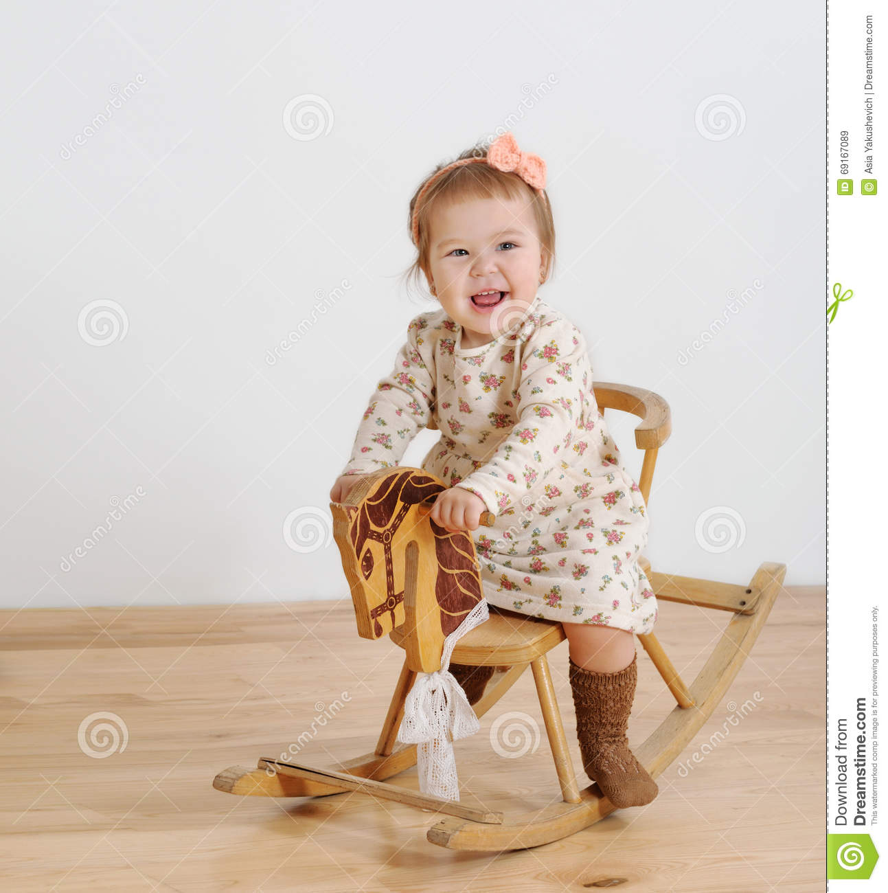 Happy Little Child And A Rocking Horse Stock Photo