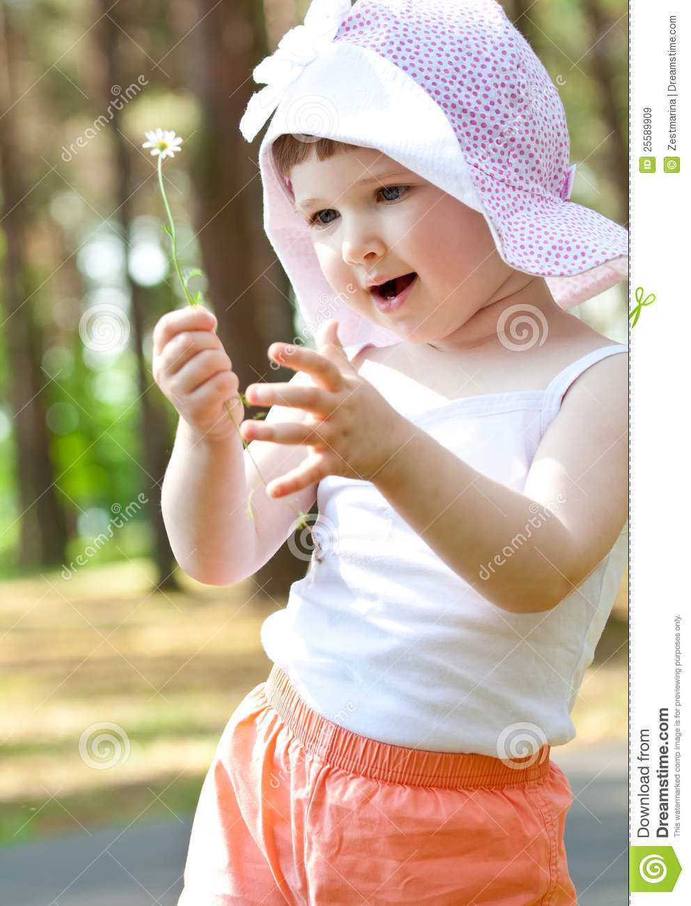 Happy Little Girl Playing With A Flower Royalty Free Stock ...