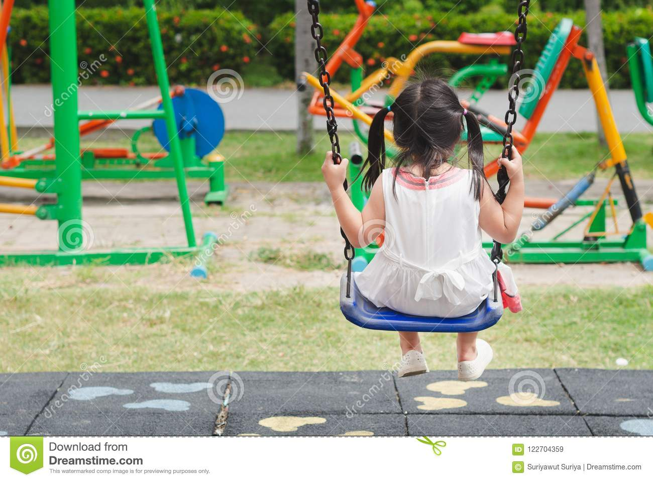 Happy little girl playing swing at the playground. Happy, Family