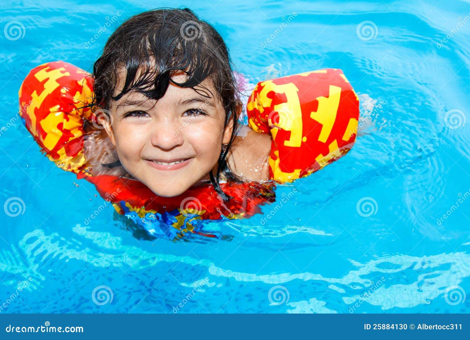 Happy little girl in pool