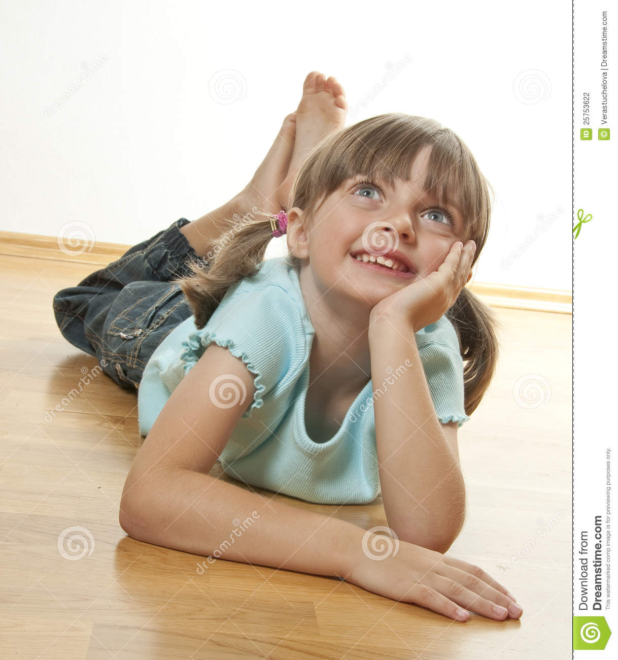 Happy Little Girl Resting On A Wooden Floor Stock