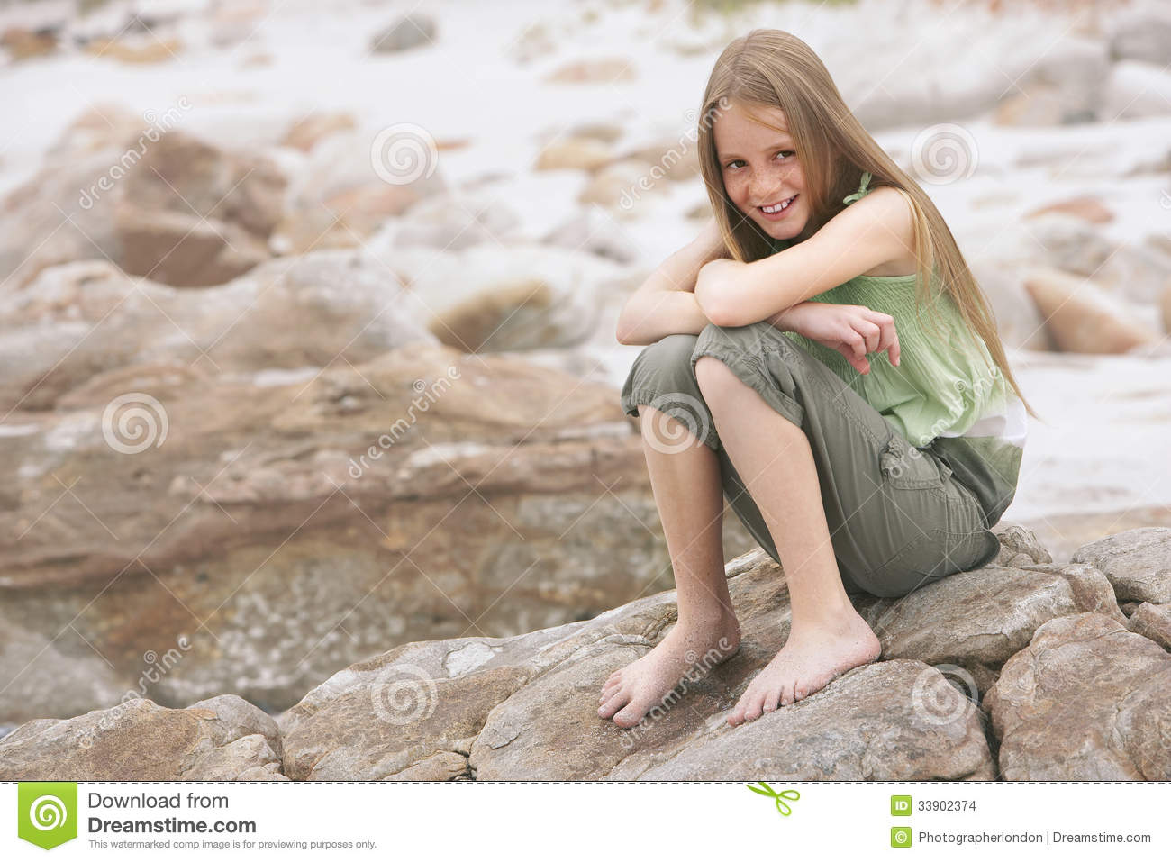 Girl sitting on rock wish