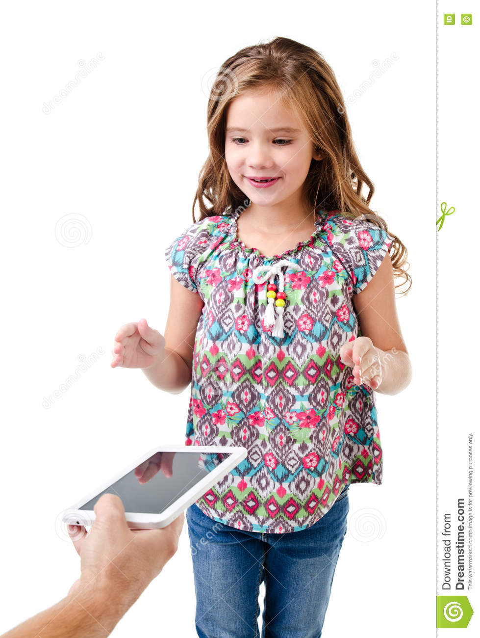 Happy little girl is taking tablet pc isolated on a white