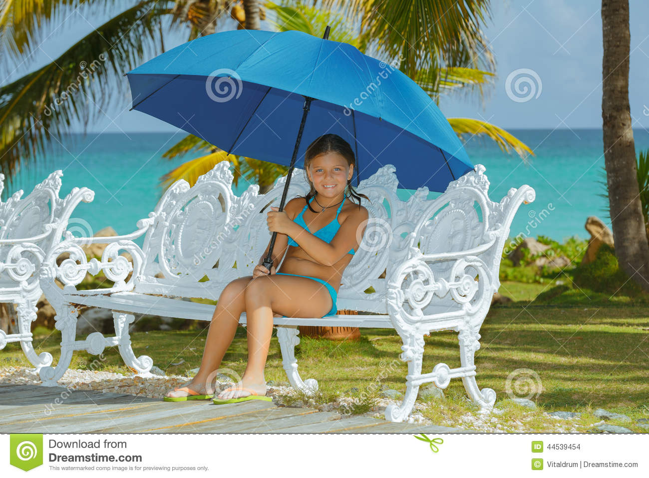 Happy Little Girl With Umbrella Sitting On Old Style