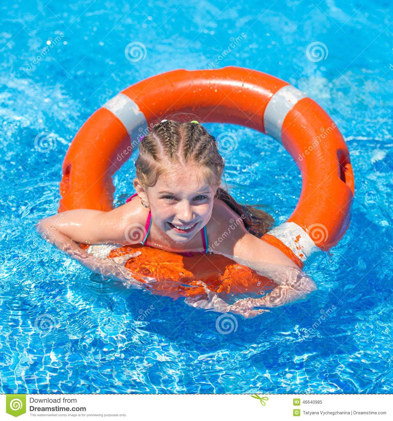 Smiling cute girl swims with a lifeline in the pool in summer 90d3d8a73