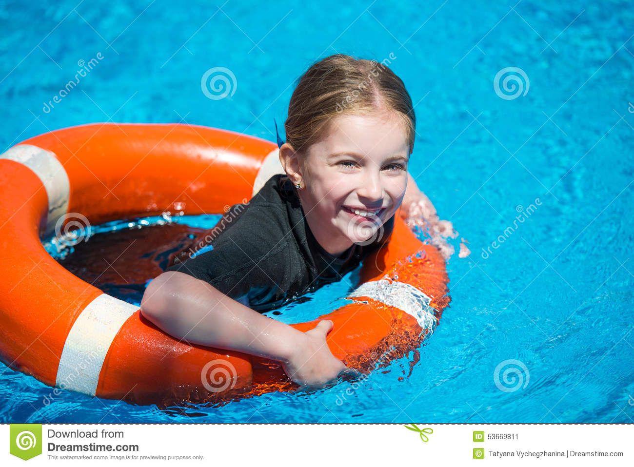 e936f1e2b3 Happy little girl in a wetsuit. Happy little girl swims in a wetsuit with a