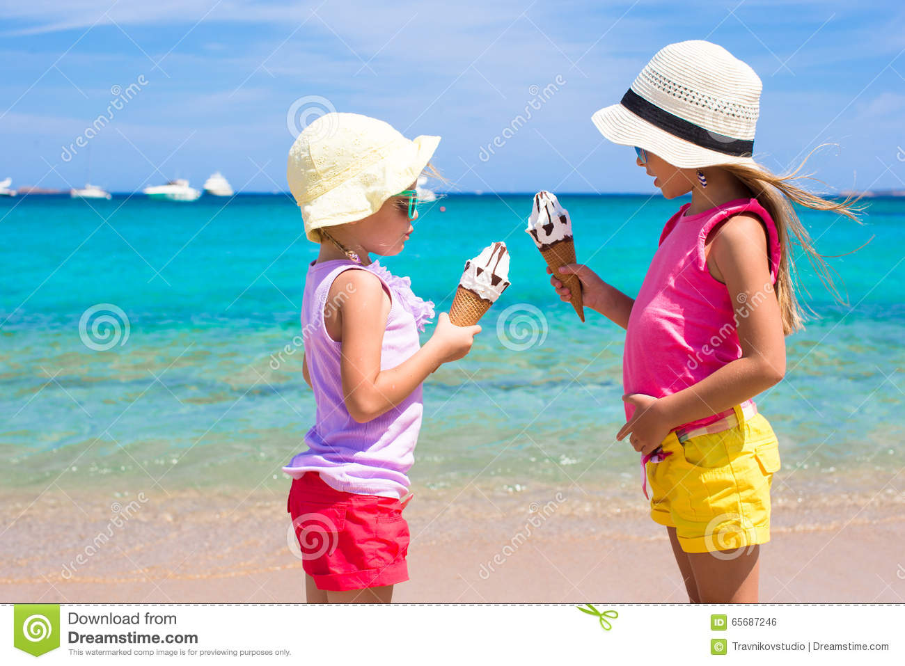 Happy Little Girls Eating Ice Cream Over Summer Beach Background People Children Friends And Friendship Concept Stock Photo 65687246