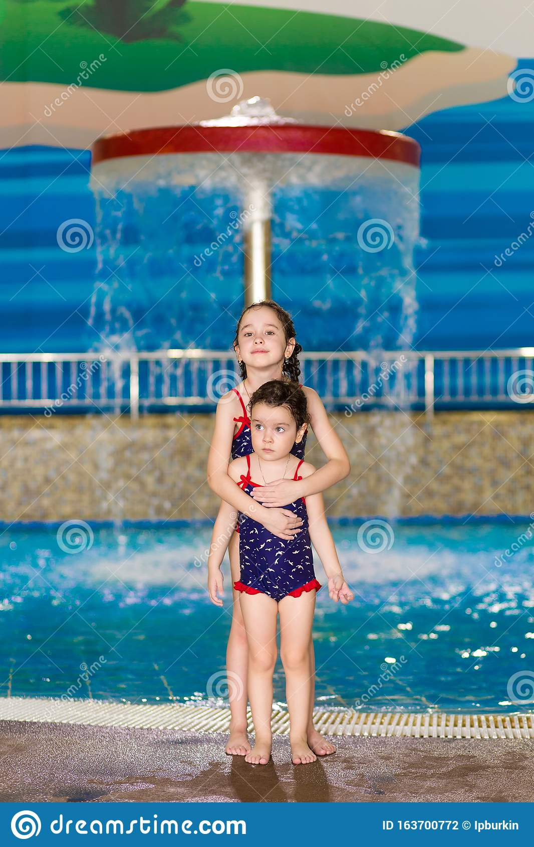 Happy Little Girls In Identical Swimsuits Posing Near The Children S Pool In The Water Park Child Learns To Swim Stock Photo Image Of People Flume 163700772