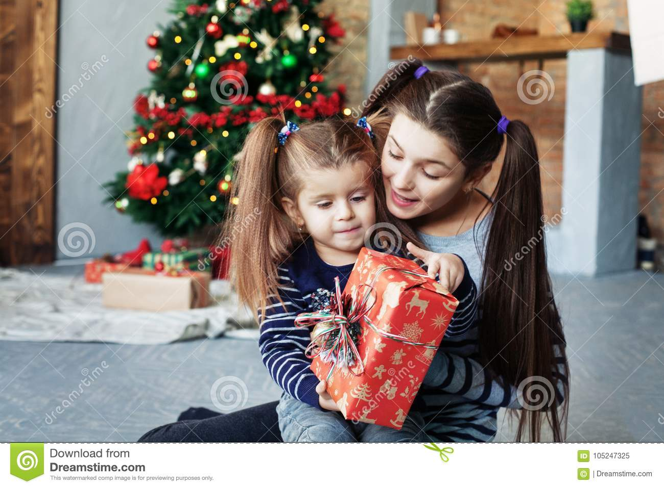 download happy little sister unpack gifts for christmas the concept of c stock image
