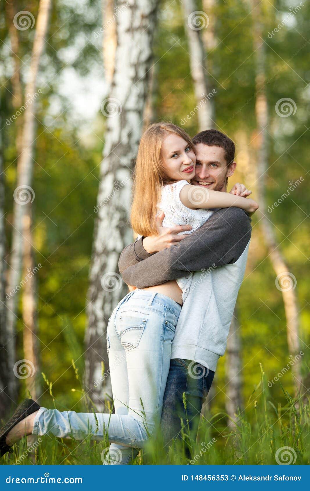 Happy lovers hugging in the birch grove