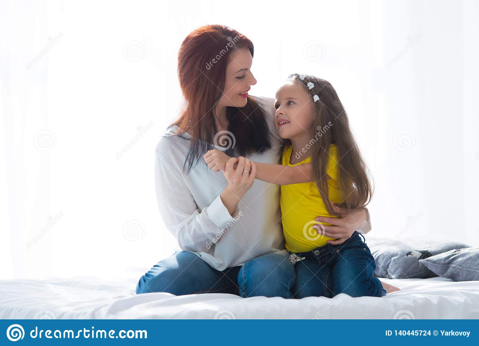 Happy loving family. Mother and her daughter child girl playing and hugging