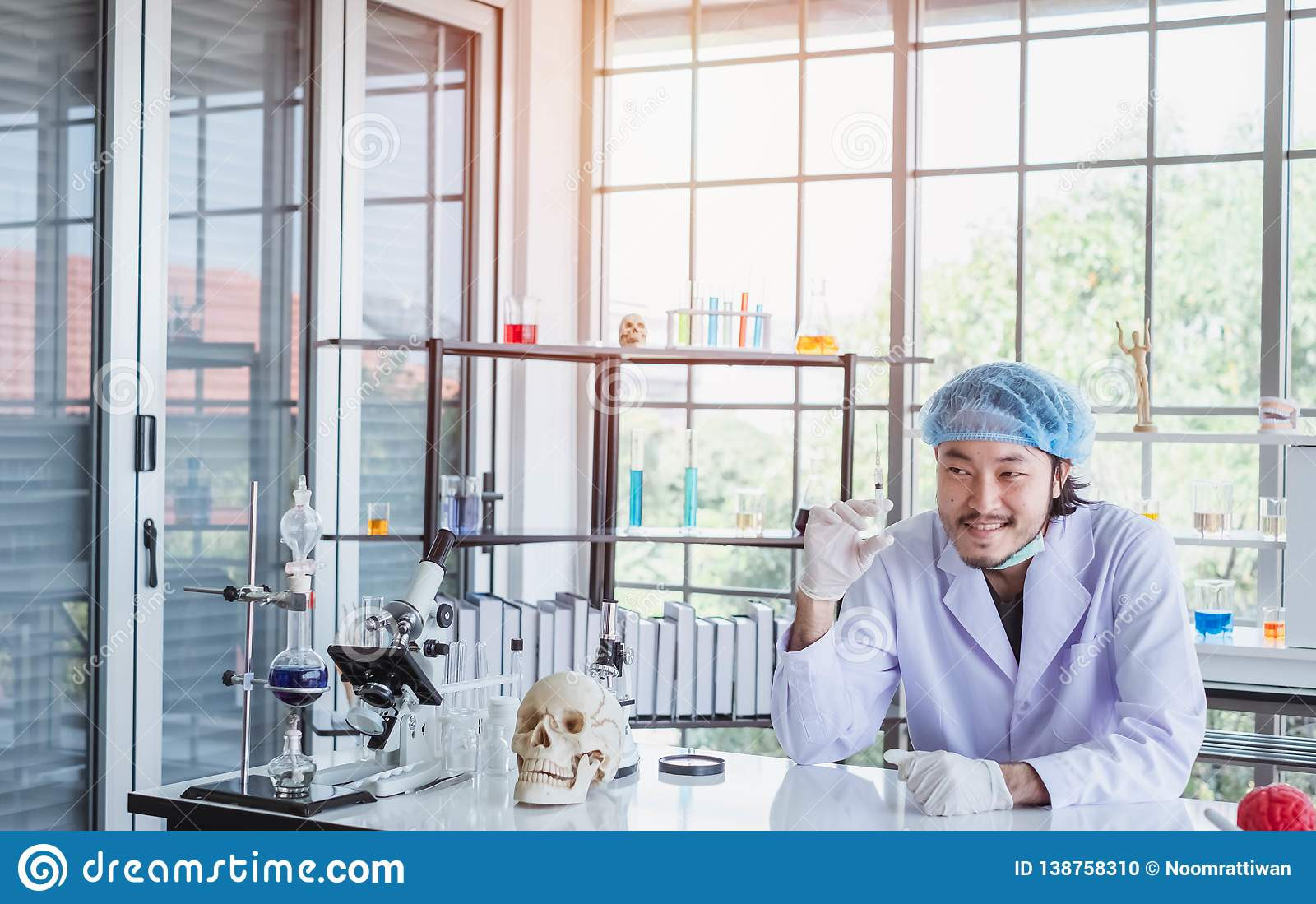 A happy male scientist showing the successful results of his experiment in a science lab