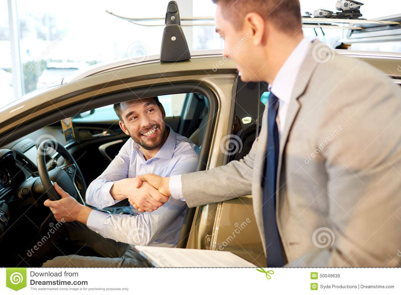 happy man with car dealer in auto show or salon stock photo image 50049639. Black Bedroom Furniture Sets. Home Design Ideas