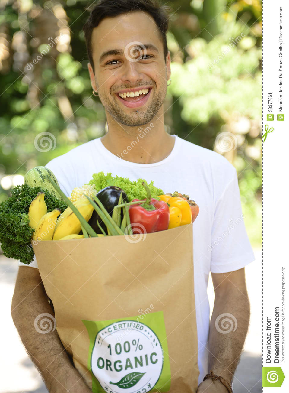 happy man carrying a bag of organic food stock image