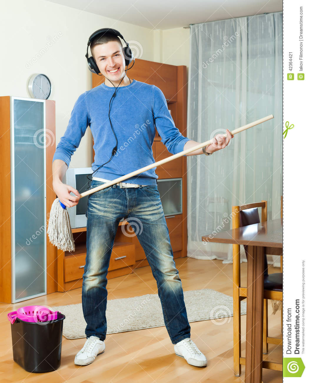 happy-man-cleaning-his-house-mop-living-