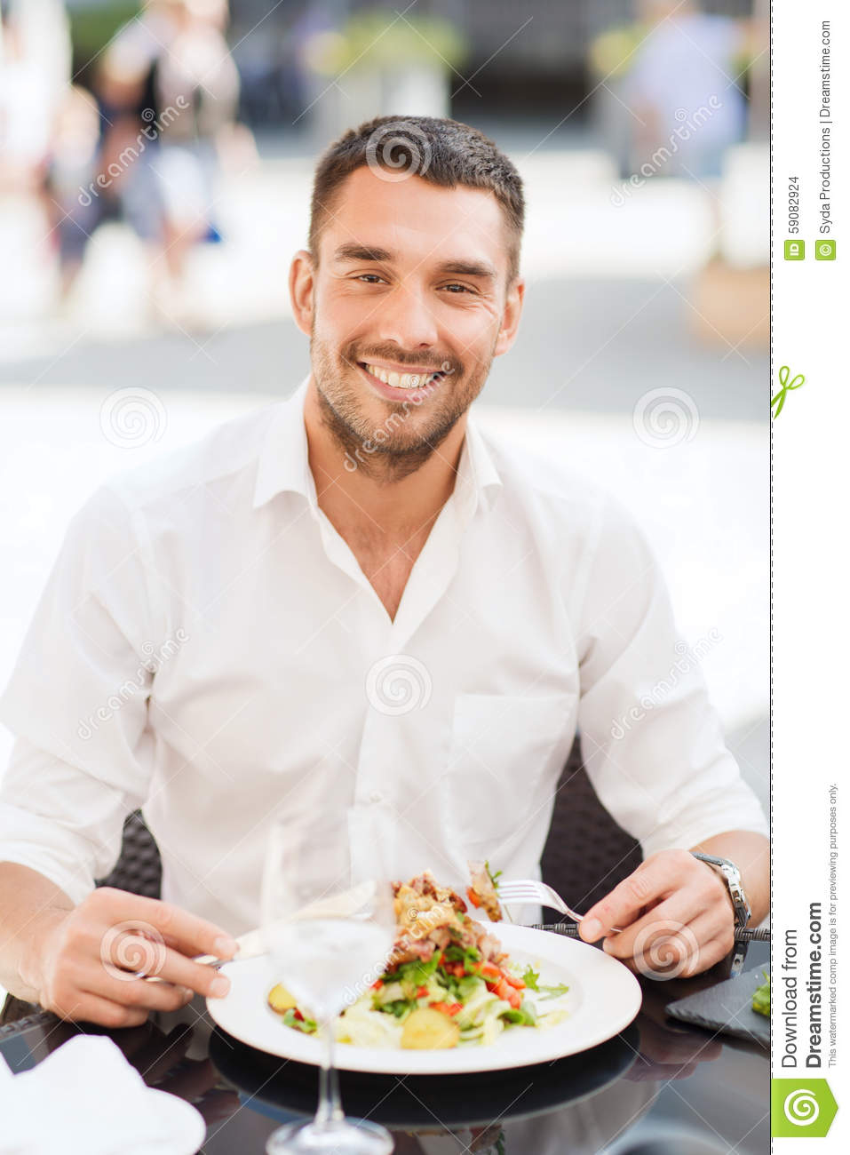 happy-man-eating-salad-dinner-restaurant