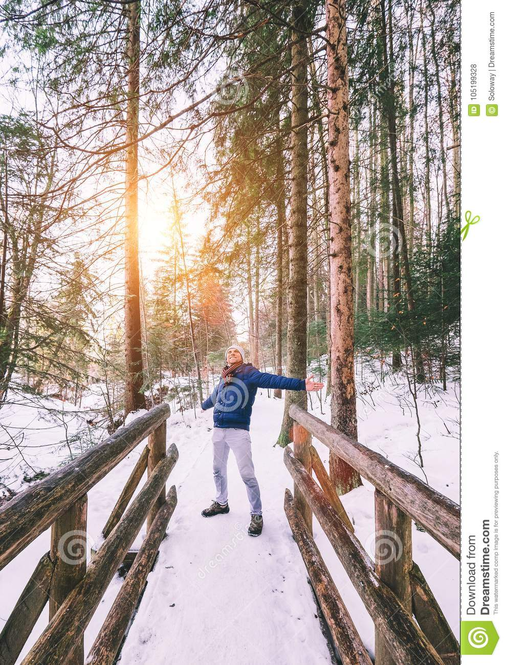 Happy man enjoy with winter walk in forest