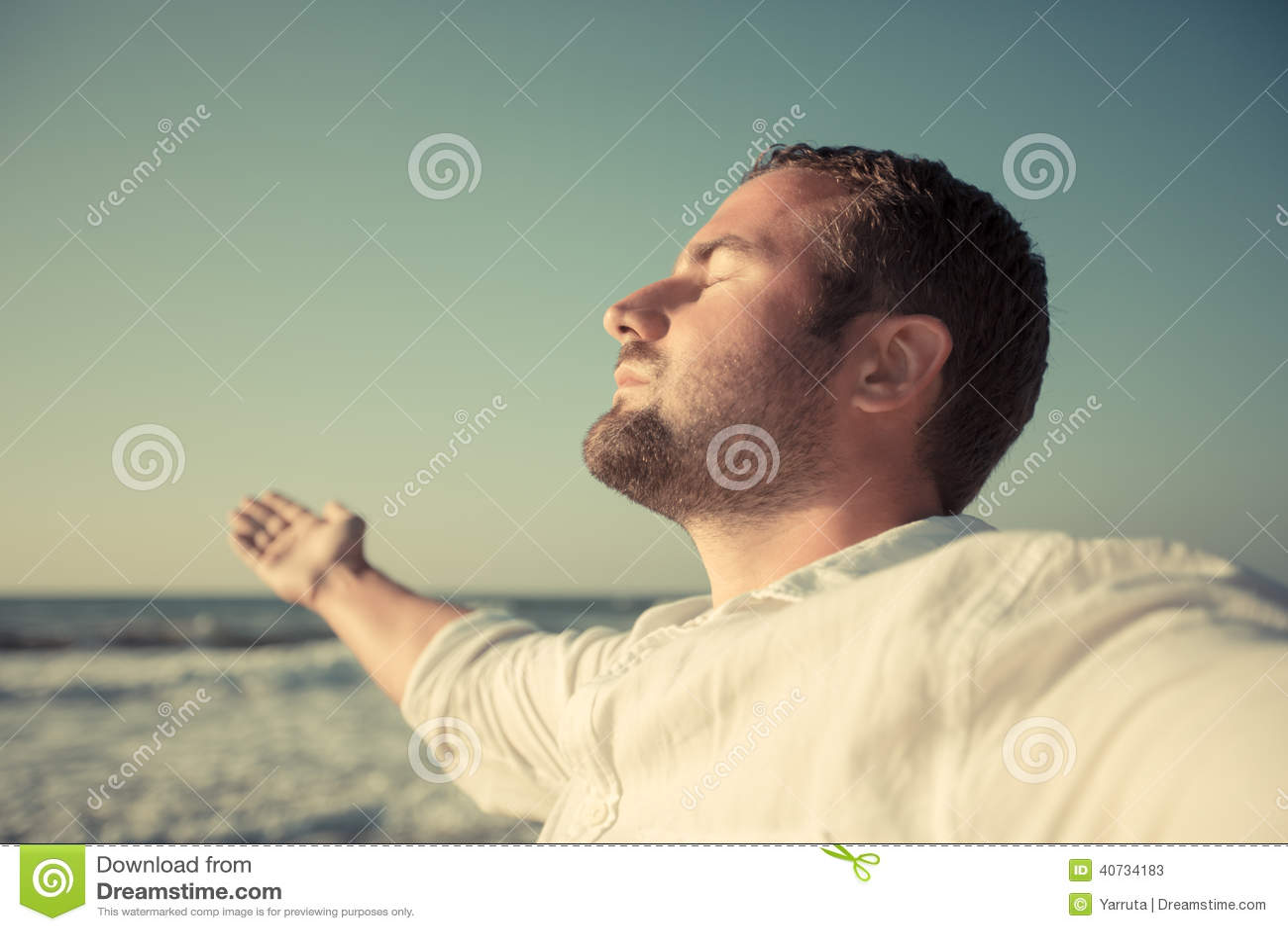 Happy man enjoying life at the beach