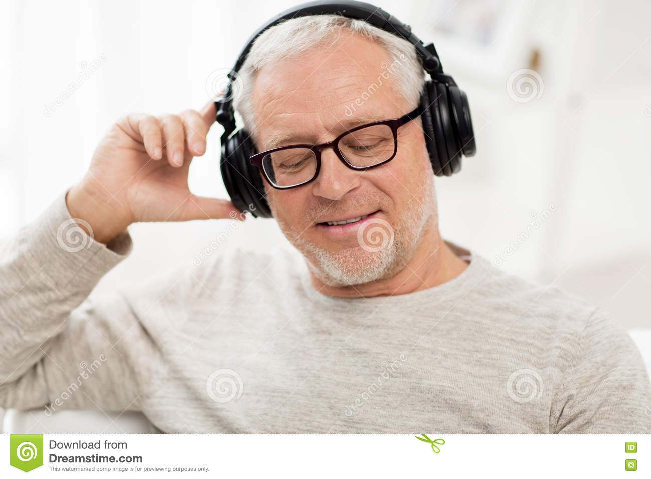 Happy Man In Headphones Listening To Music At Home Stock ...