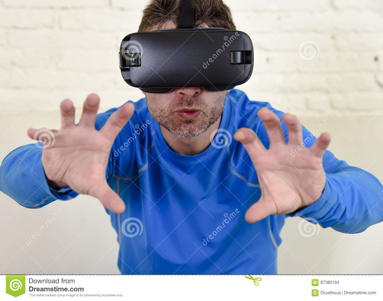 Happy man at home living room sofa couch excited using 3d goggles watching 360 virtual reality
