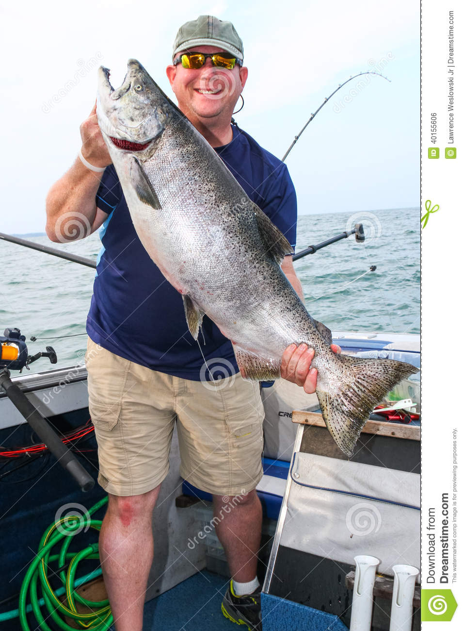 Happy man with huge fish giant king salmon stock photo for Salmon fishing lake ontario