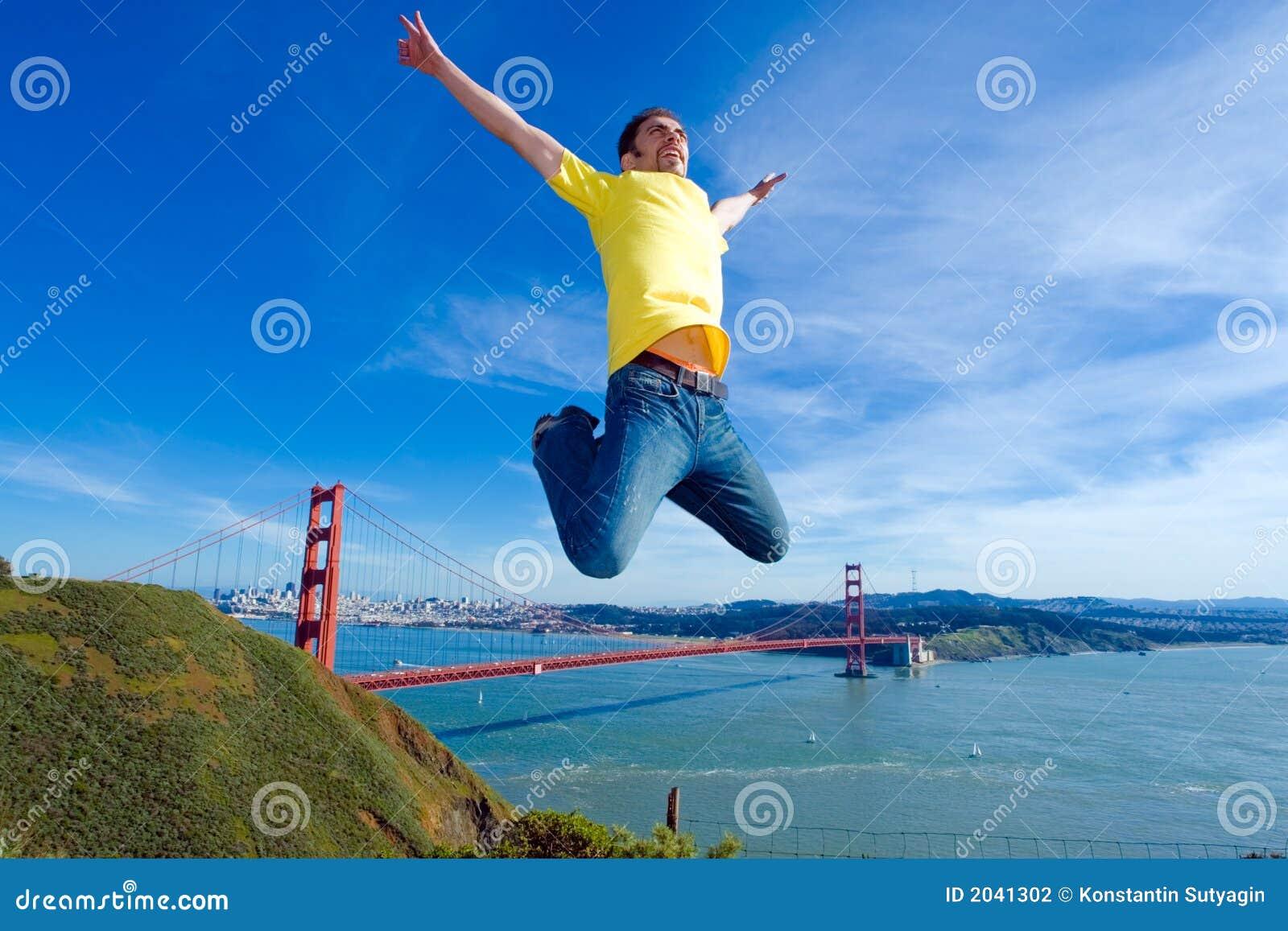 Happy man jumping in San Francisco