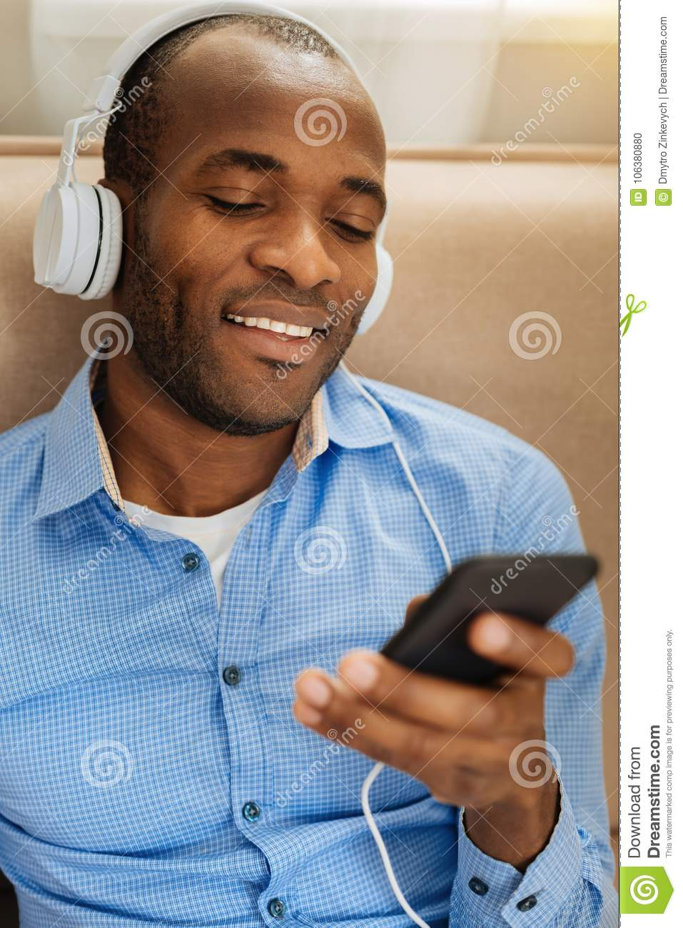 Happy Man Listening To Music And Relaxing Stock Photo