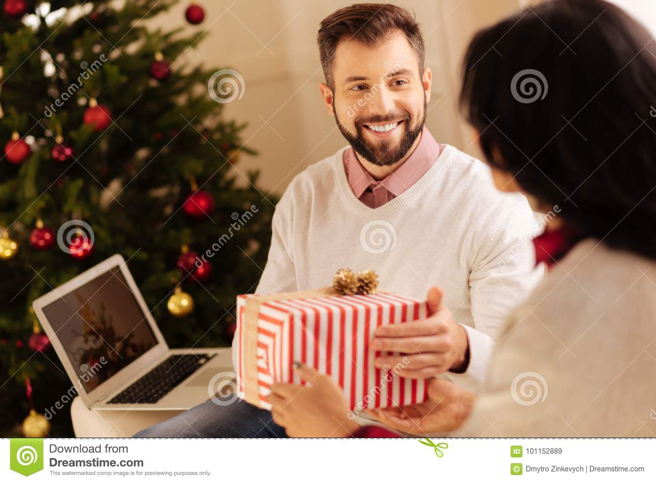 Happy Man Receiving Christmas Gift From His Wife Stock Image - Image ...