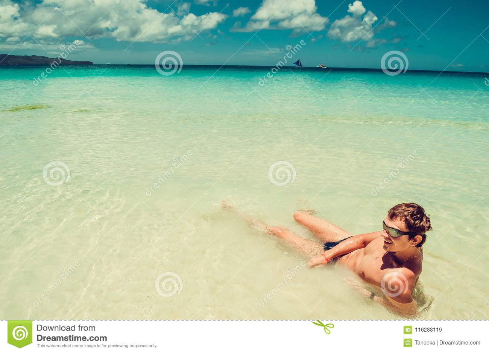 happy man in swimming goggles relax in sea enjoying summer beach