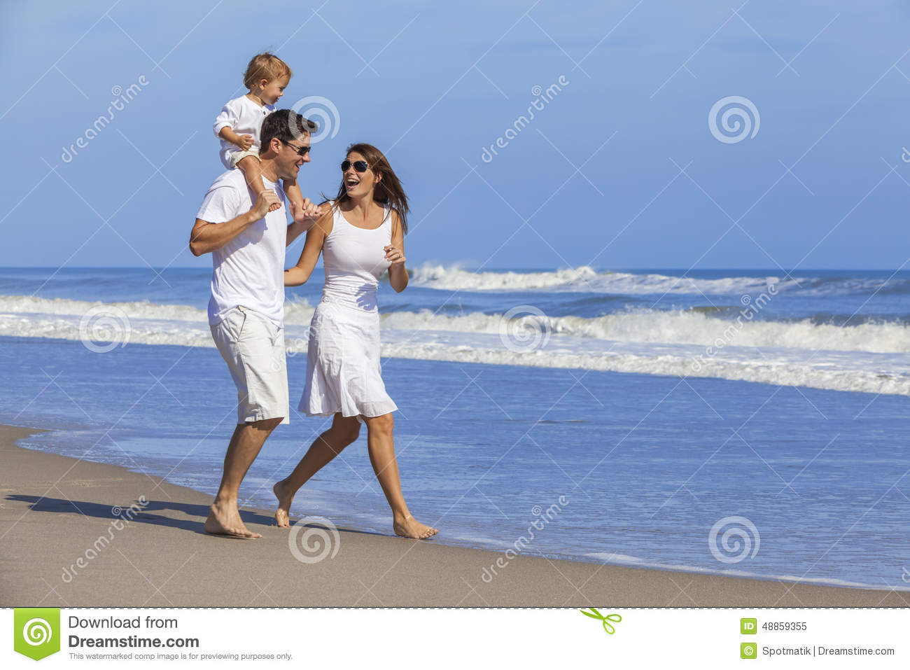 Happy Man Woman Child Family Playing on Beach