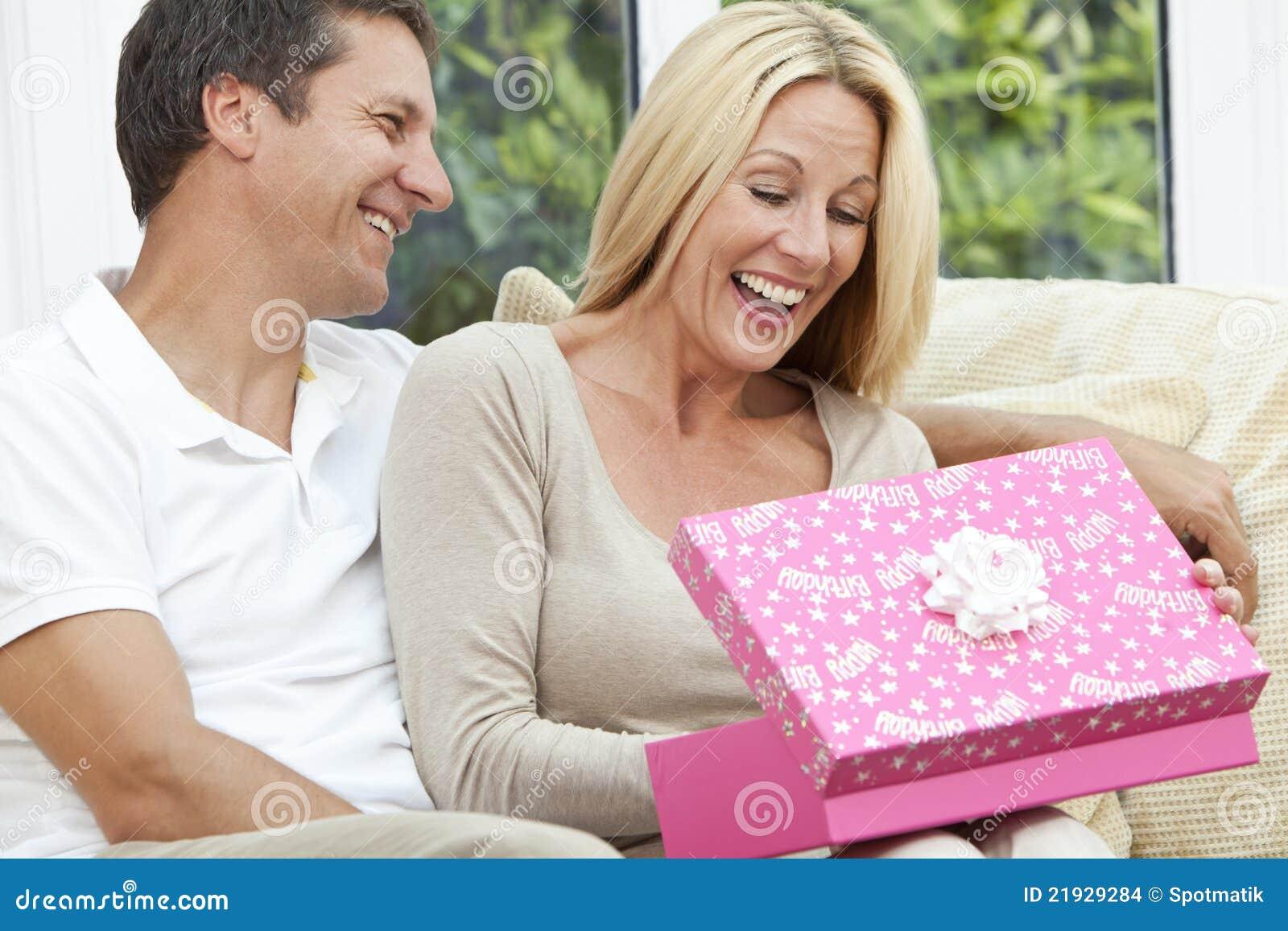 happy-man-woman-couple-opening-birthday-