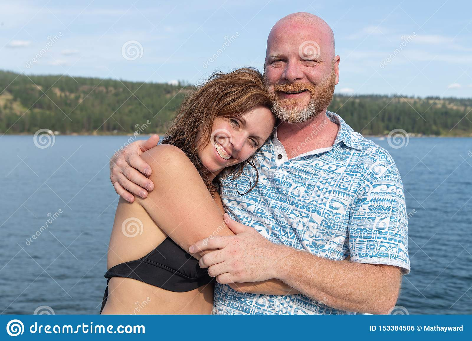 Happy Man and Woman together at a lake