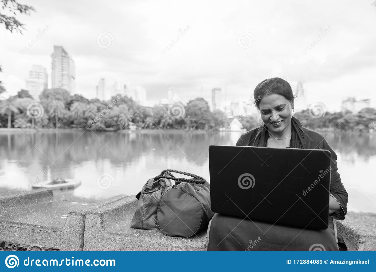 Happy Mature Beautiful Indian Woman Using Laptop At The Park Stock Image Image Of Computer Black 172884089