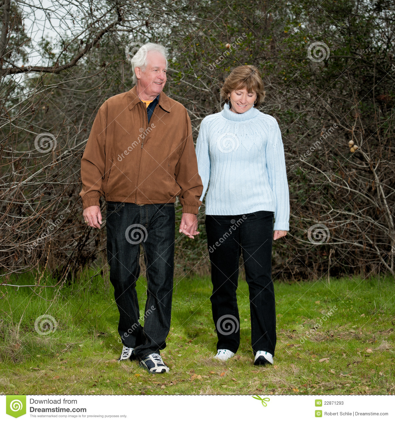 Happy mature couple walking outdoors