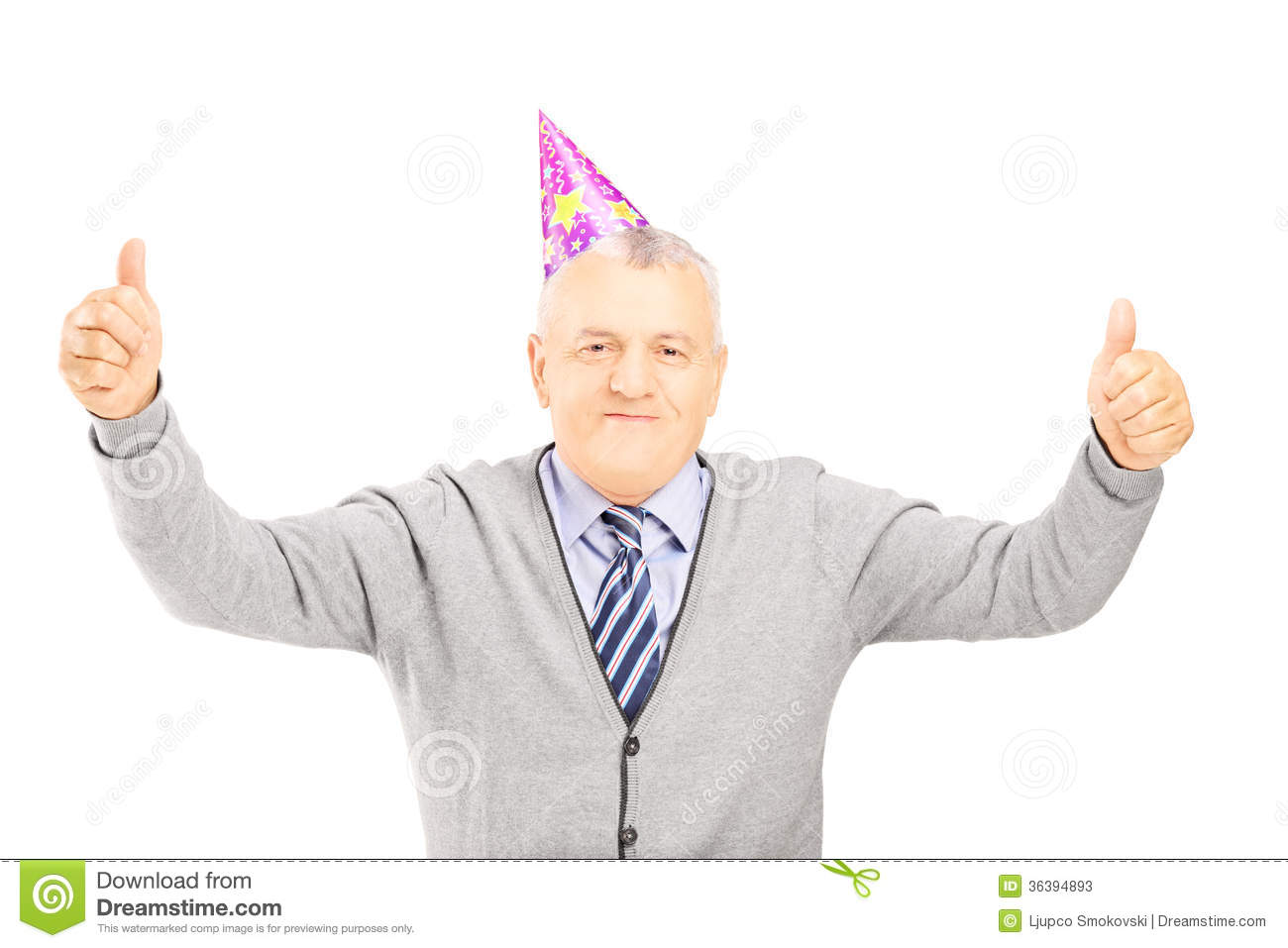 happy mature gentleman with party hat giving thumbs up stock image