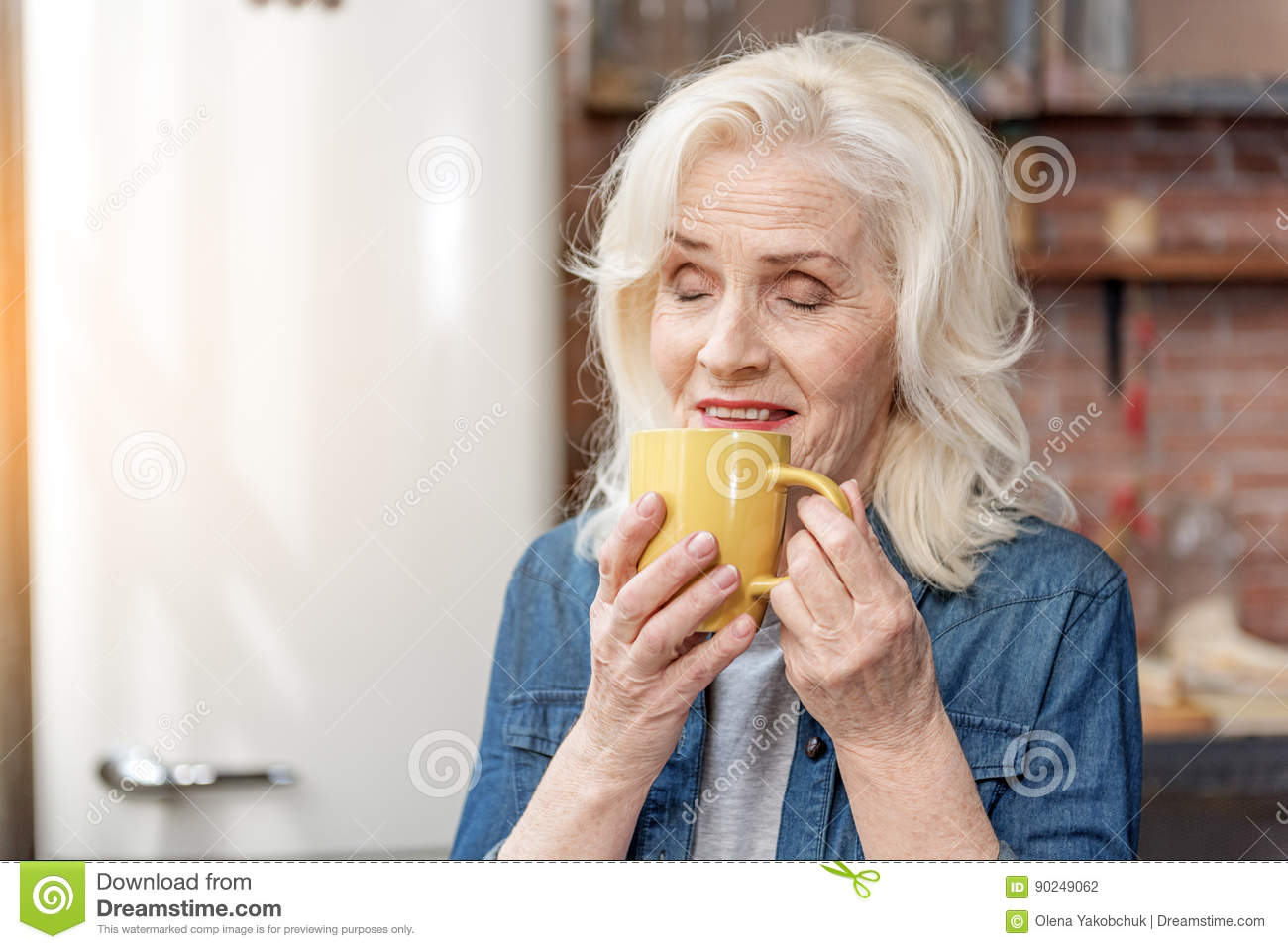 happy mature lady relaxing with hot beverage stock photo - image of