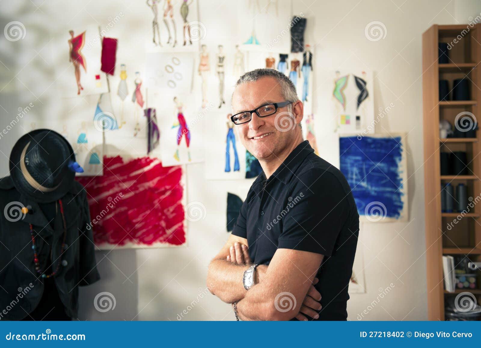 Happy mature man working as fashion designer