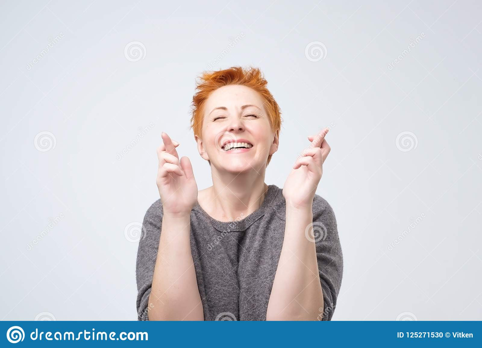 Mature redhead in white